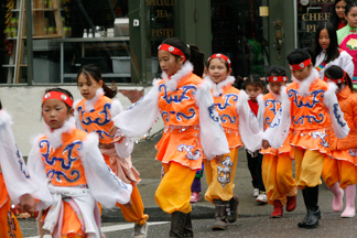 Chinese New Year Kids in orange costumes
